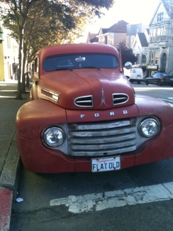 An old car I saw along Hayes Street one day. The plate number is hilarious!